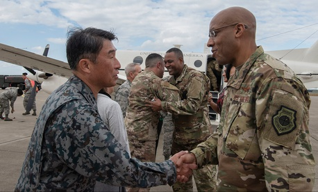 Japan Air Self-Defense Force Lt. Gen. Tamotsu Kidono and U.S. Air Force Gen. CQ Brown shake hands at Misawa Air Base, Japan.
