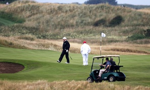 Donald Trump walks off the 4th green while playing at Turnberry golf club in Scotland in July.