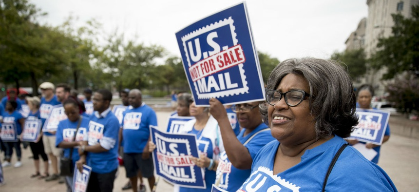Postal workers rally in October against privatization. Ultimately the task force did not recommend privatization.