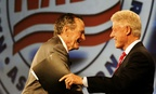 Former Presidents George H. W. Bush and Bill Clinton greet each other in New Orleans in 2009.
