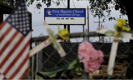 Memorials and messages hang on a fence at the First Baptist Church of Sutherland Springs, near the one-year anniversary of the shooting.