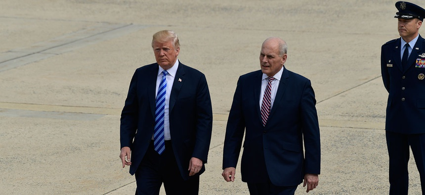 President Donald Trump and White House Chief of Staff John Kelly walk on the tarmac at Andrews Air Force Base in May.