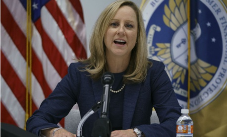 New Consumer Financial Protection Bureau Director Kathy Kraninger holds a press conference Tuesday.