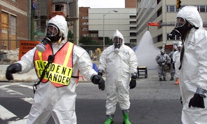 Baltimore City Fire Department Hazmat team battalion Chief Mark Wagner, left, guides operations during an emergency training exercise put on by the University of Maryland Medical Center and the U.S. Air Force to simulate a bioterror attack.