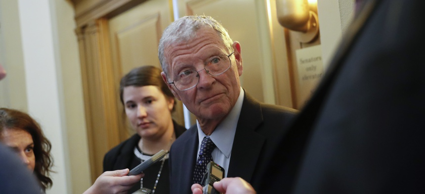 Sen. James Inhofe, R-Okla., stops to speak to members of the media after attending the weekly GOP conference luncheon at the Capitol in Washington, Tuesday, Aug. 28, 2018.