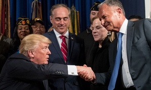 Before signing a bill, President Donald Trump shakes hands with Isaac Perlmutter, CEO of Marvel, in Washington, DC.