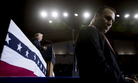 A Secret Service agent stands guard as Trump speaks at a rally in October. A measure on Trump's desk would boost pay caps for the Secret Service.