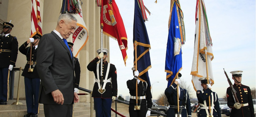 Defense Secretary Jim Mattis walks down the steps of the Pentagon on Wednesday, Dec. 19.