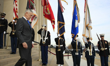 Defense Secretary Jim Mattis walks down the steps of the Pentagon on Wednesday, Dec. 19.