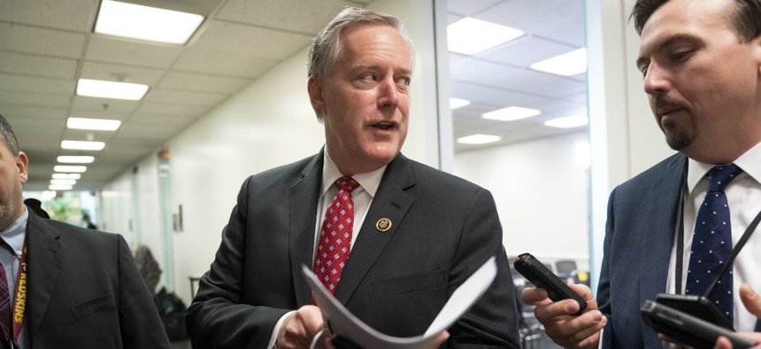 Rep. Mark Meadows, R-N.C., heads into a Republican strategy meeting on Thursday.