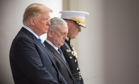 Donald J. Trump, Secretary of Defense James N. Mattis and Chairman of the Joint Chiefs of Staff Marine Gen. Joseph F. Dunford Jr., bow their heads during a Memorial Day ceremony in May.
