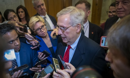 Senate Majority Leader Mitch McConnell spoke to reporters Friday about efforts to avoid a partial government shutdown.