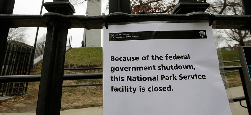 A sign is posted on a fence near an entrance to the Bunker Hill Monument Monday.