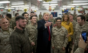 President Trump and first lady Melania Trump pose for a photograph as they visit members of the military at Al Asad Air Base, Iraq, Dec. 26, in a surprise trip to Iraq.