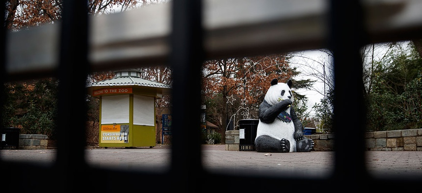 A panda statue is seen beyond the closed gate at Smithsonian's National Zoo, Wednesday, Jan. 2, 2019.
