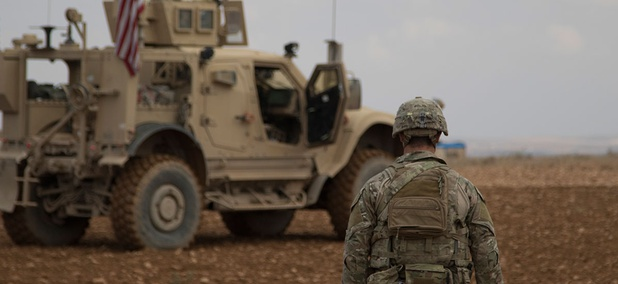 A soldier walks toward a tactical vehicle after completing a successful combined joint patrol rehearsal in Manbij, Syria in November.