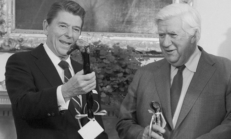 President Ronald Reagan and House Speaker Thomas P. O'Neill of Mass., share a laugh as they are presented a pair of walking sticks at the White House, Dec. 10, 1981.