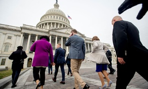Members of Congress, including House Speaker Nancy Pelosi of Calif., second from right, walk toward the Capitol building, Jan. 4, 2019.