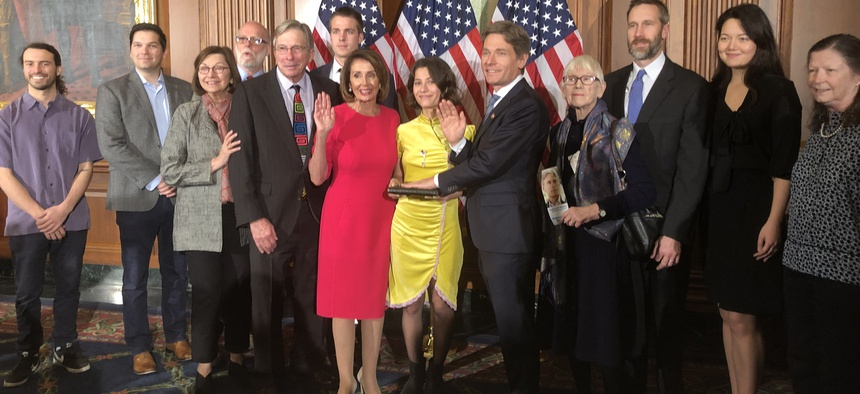 Rep. Tom Malinowski, D-N.J., and family members at a ceremonial swearing-in with House Speaker Nancy Pelosi.
