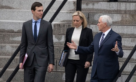 White House Senior Adviser Jared Kushner, left, Homeland Security Secretary Kirstjen Nielsen, and Vice President Mike Pence, talk as they walk down the steps of the Eisenhower Executive Office Building on Saturday