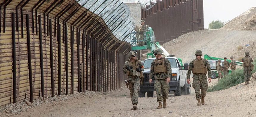 Marines with the 7th Engineer Support Battalion, Special Purpose Marine Air-Ground Task Force 7, walk along the California-Mexico border at the Andrade Point of Entry in Winterhaven, California, in November.
