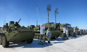 In this photo taken on Tuesday, April 25, 2017, soldiers of the Arctic motorised rifle brigade of Russia's Northern Fleet took stand near APCs during military exercise in Alakyrtti, Murmansk region, Russia.