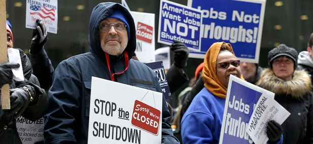Government workers rally against the partial government shutdown at Federal Plaza on Thursday in Chicago.