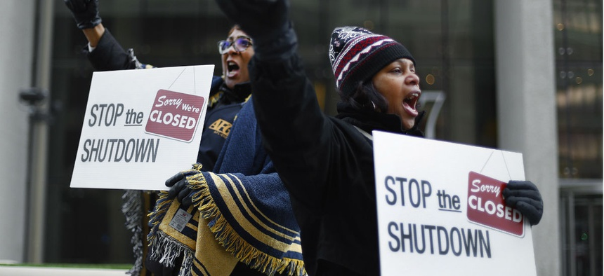Federal employees rally in Detroit for an end to the shutdown.