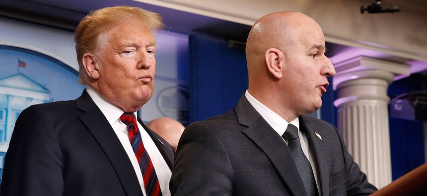 President Donald Trump, left, listens as Brandon Judd, president of the National Border Patrol Council, talks about border security on Jan. 3.