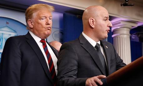 President Donald Trump, left, listens as Brandon Judd, president of the National Border Patrol Council, talks about border security on Jan. 3.