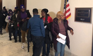 Service contractors affected by the shutdown line up outside Senate Majority Leader Mitch McConnell's office to show him their unpaid bills.