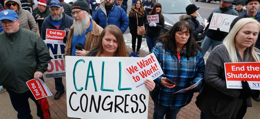 Federal employees and their allies rallied outside the Federal Building in Ogden, Utah on Jan. 10.