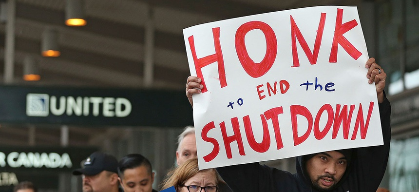 More than two dozen federal employees and supporters demonstrated at the Sacramento International Airport on Wednesday.