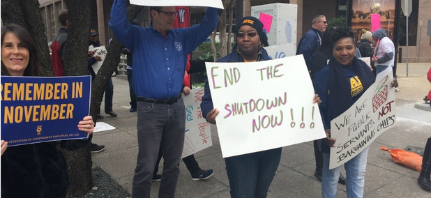 Union members rally in Dallas earlier this month to end the shutdown.