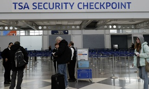 A security checkpoint at Chicago's O'Hare International Airport. TSA agents have started calling in sick at greater rates than usual as the shutdown drags on.