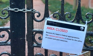 A notice of closure from NPS at the gate of the 18th Century Garden at Independence Hall National Historic Site in Philadelphia in December.