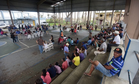 People gather at the Jose de Diego Elementary School to file FEMA forms for federal aid in the aftermath of Hurricane Maria in Las Piedras in Oct. 2017.
