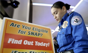A TSA employee stands at a booth to learn about a food stamp program at a food drive at Newark Liberty International Airport on Jan. 23.