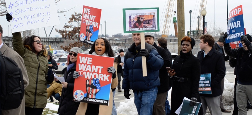 Federal employees and their allies rallied against the shutdown in Washington on Jan. 17.