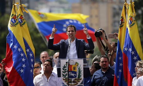 Juan Guaido, head of Venezuela's opposition-run congress, declares himself interim president of the nation until elections can be held during a rally demanding President Nicolas Maduro's resignation in Caracas on Wednesday.