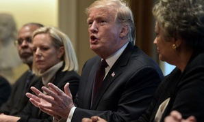 President Donald Trump, second from right, speaks in the Cabinet Room of the White House in Washington, Wednesday, Jan. 23, 2019, as he hosts a roundtable with conservative leaders to discuss the security and humanitarian crisis at the southern border.
