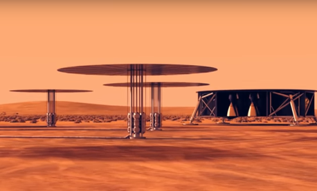 A still shot from a NASA simulation showing how small nuclear reactors might power colonies on Mars.