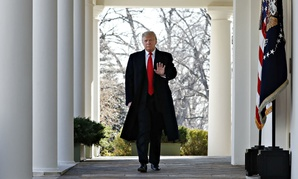 President Trump waves as he walks from the Oval Office to announce a deal to temporarily reopen the government on Jan. 25.