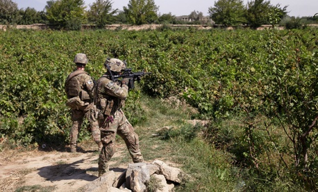 U.S. troops patrol Dolana village of Parwan province, Afghanistan, in 2014.