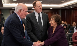 Senator Patrick Leahy, Senator Richard Shelby, and Representative Nita Lowey greet one another at Wednesday's conference-committee meeting at the Capitol.