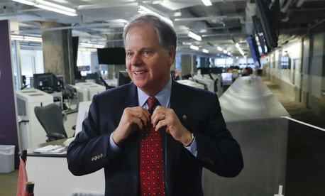 Sen. Doug Jones, D-Ala., says federal workers should be paid interest on wages delayed during the shutdown.