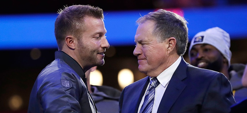 Los Angeles Rams head coach Sean McVay, left, shakes hands with New England Patriots head coach Bill Belichick in Atlanta on Monday.