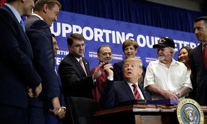 President Donald Trump hands a pen to Veterans Affairs Secretary Robert Wilkie during a spending bill signing ceremony in Las Vegas in September.
