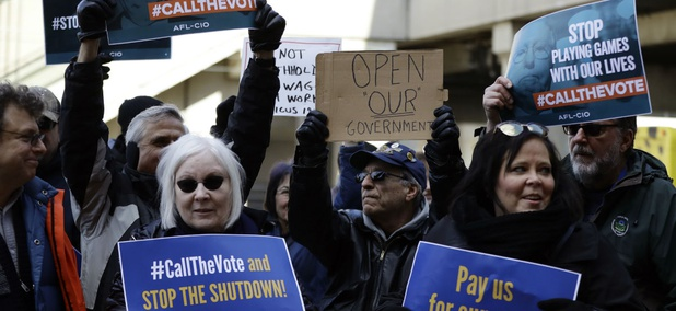 Union and labor supporters demonstrate at a rally by federal workers at the Philadelphia International Airport to end the government shutdown on Friday, Jan. 25.