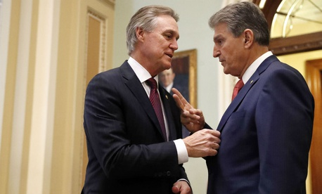 Senators David Perdue, R-Ga., left, and Joe Manchin, D-W.Va., are among the bipartisan group that have expressed concern about the Pentagon's ability to improve financial management.